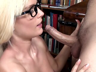A blonde almost glasses is possessions penetrated in the library by her friend